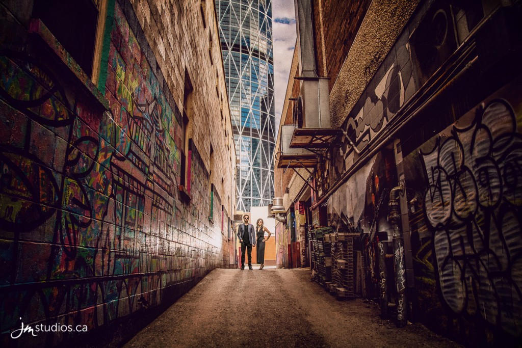 Jemmica and Jon's #Engagement Session in the Downtown Core (Stephens Ave, Graffiti Alley, Subrosa, Society Coffee). #EngagementPhotos by Calgary Engagement Photographers JM Photography © 2018 http://www.JMstudios.ca #JMweddings #JMstudios #JMphotography #EngagementPhotography #EngagementPhotos #SocieteCoffee #Graffiti #GraffitiAlley #StephensAve #TheBow